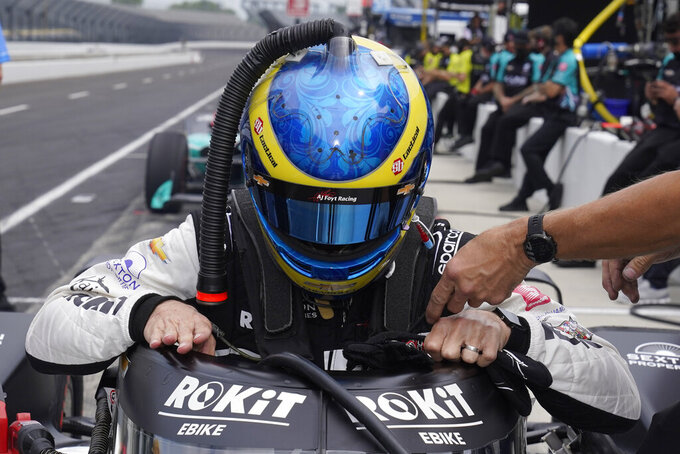 Sebastien Bourdais, of France, climbs into his car during practice for the Indianapolis 500 auto race at Indianapolis Motor Speedway, Wednesday, May 19, 2021, in Indianapolis. (AP Photo/Darron Cummings)