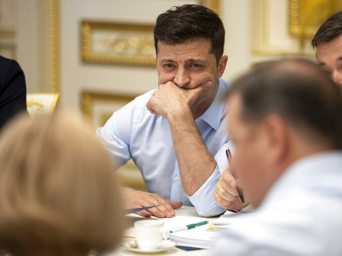 Ukrainian president Volodymyr Zelenskiy attends a meeting with the lawmakers in Kiev, Ukraine, Tuesday, May 21, 2019. Ukraine's new president on Tuesday ordered the dissolution of the nation's legislature and called a snap election in two months, hoping to ride the wave of his electoral success to get his supporters into parliament. (Ukrainian Presidential Press Office via AP)