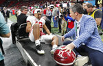 Alabama quarterback Tua Tagovailoa is taken off the field after the Southeastern Conference championship NCAA college football game between Georgia and Alabama, Saturday, Dec. 1, 2018, in Atlanta. Alabama won 35-28. (AP Photo/John Bazemore)