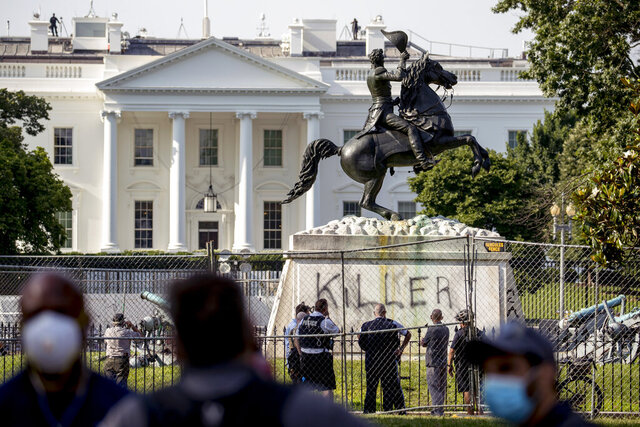 The White House is visible behind a statue of President Andrew Jackson in Lafayette Park, Tuesday, June 23, 2020, in Washington, with the word