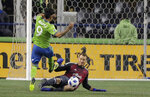 Seattle Sounders forward Raul Ruidiaz (9) has a shot deflected by Portland Timbers goalkeeper Jeff Attinella during the first half of the second leg of an MLS playoff soccer series Thursday, Nov. 8, 2018, in Seattle. (AP Photo/Ted S. Warren)