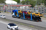 A truck carries new cars on the motorway leading to Paris, Tuesday, May 26, 2020 in Villacoublay, west of Paris. French President Emmanuel Macron is set to unveil on Tuesday new measures to rescue the country's car industry, which has been hammered by the virus lockdown and the resulting recession. The issue is politically sensitive, since France is proud of its auto industry, which employs 400,000 people in the country and is a big part of its manufacturing sector. (AP Photo/Michel Euler)