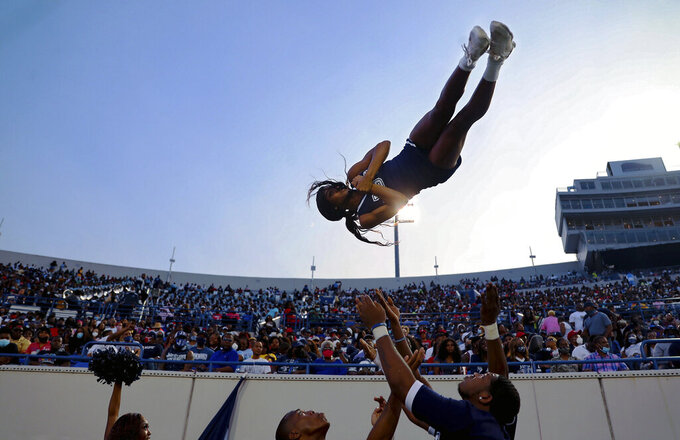 Jackson State cheerleader Essence Rentie gets tossed up in the air before the Southern Heritage Classic NCAA college football game against Tennessee State in Memphis, Tenn., Saturday, Sept. 11, 2021. (Patrick Lantrip/Daily Memphian via AP)