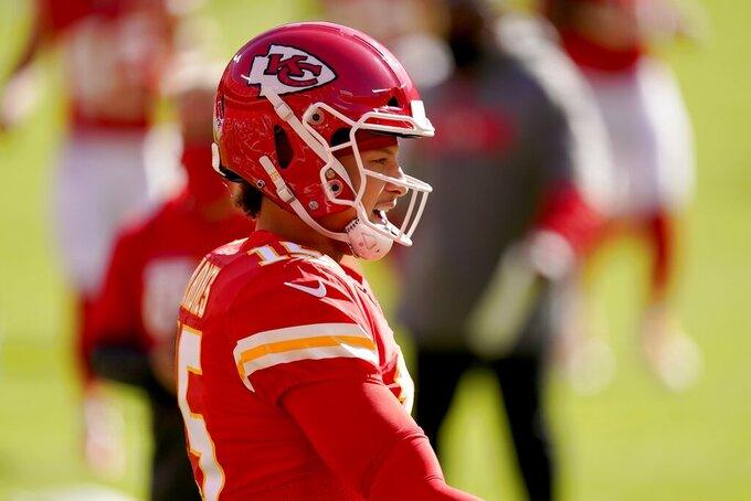 Kansas City Chiefs quarterback Patrick Mahomes warms up before an NFL football game against the New York Jets on Sunday, Nov. 1, 2020, in Kansas City, Mo. (AP Photo/Charlie Riedel)