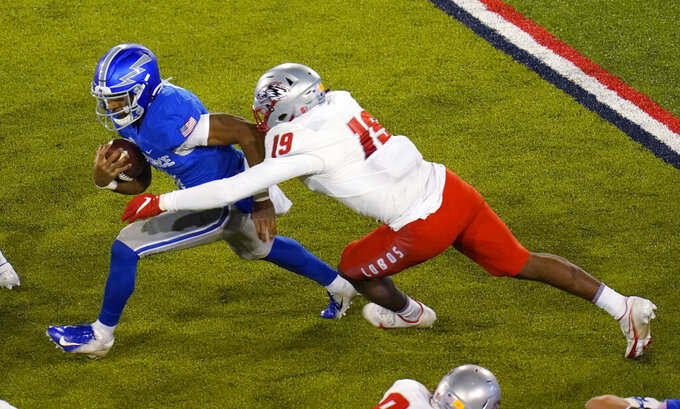 Air Force quarterback Haaziq Daniels, left, is sacked by New Mexico linebacker Devin Sanders during the second half of an NCAA college football game Friday, Nov. 20, 2020, at Air Force Academy, Colo. (AP Photo/David Zalubowski)