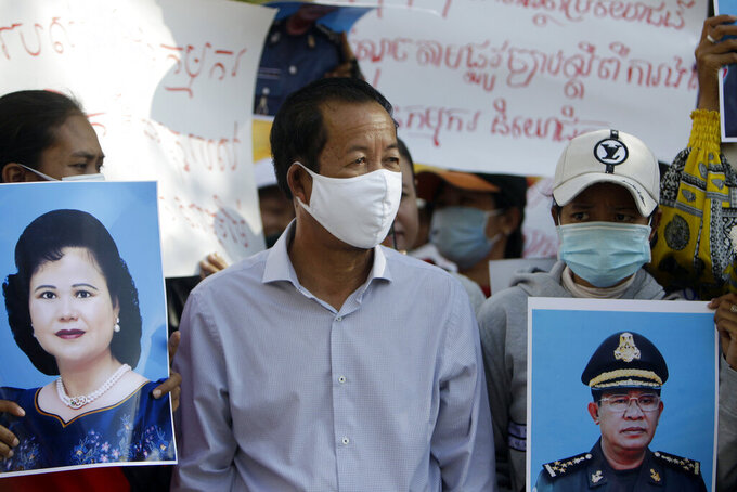 Rong Chhun, president of the Cambodian Confederation of Unionsstands during a protest near the prime minister's residence in Phnom Penh, Cambodia July 29, 2020. Rong Chhun was arrested Friday, July 31 on a charge of inciting social unrest because of his comments about a politically sensitive matter concerning the country's borders. (AP Photo/Heng Sinith)