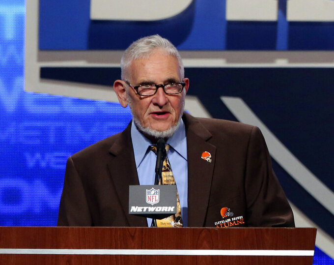 FILE - In this April 26, 2013, file photo, former Cleveland Browns player Dick Schafrath announces an NFL football draft pick during the third round at Radio City Music Hall in New York. Schafrath, an offensive tackle who blocked for Browns Hall of Fame running backs Jim Brown, Leroy Kelly and Bobby Mitchell before going into politics after retiring, has died. He was 84. The team said Schafrath died on Sunday, Aug. 15, 2021. No cause of death was given. (AP Photo/Mary Altaffer, File)