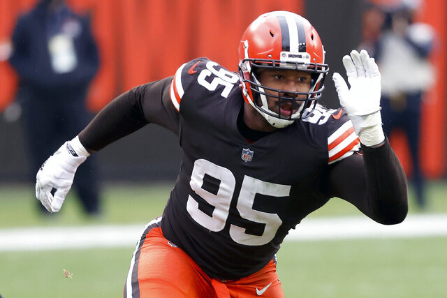 FILE - Cleveland Browns defensive end Myles Garrett (95) runs off of the line of scrimmage during an NFL football game against the Pittsburgh Steelers in Cleveland, in this Sunday, Jan. 3, 2021, file photo. Garrett was selected Friday, Jan. 8, 2021, to The Associated Press All-Pro Team. (AP Photo/Kirk Irwin, File)