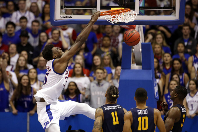 Kansas center Udoka Azubuike (35) dunks the ball during the second half of an NCAA college basketball game against East Tennessee State Tuesday, Nov. 19, 2019, in Lawrence, Kan. Kansas won 75-63. (AP Photo/Charlie Riedel)