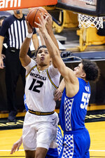Missouri's Dru Smith, left, shoots past Kentucky's Lance Ware, right, during the second half of an NCAA college basketball game Wednesday, Feb. 3, 2021, in Columbia, Mo. (AP Photo/L.G. Patterson)