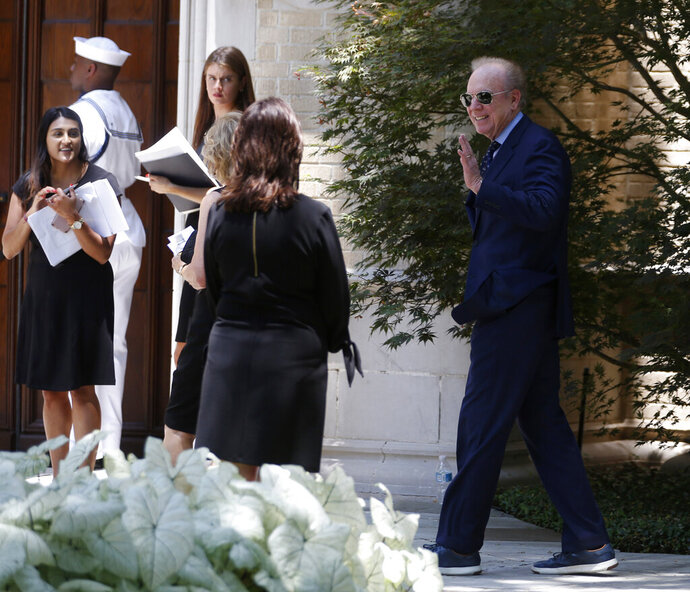Roger Staubach makes his way to the entrance, before the start of a memorial service for Henry Ross Perot at Highland Park United Methodist Church in Dallas, on Tuesday, July 16, 2019. H. Ross Perot, a hard-charging Texan with a folksy manner who made billions in business and twice sought the presidency, was celebrated at the memorial service for his devotion to his family, friends, faith and country. (Vernon Bryant/The Dallas Morning News via AP)