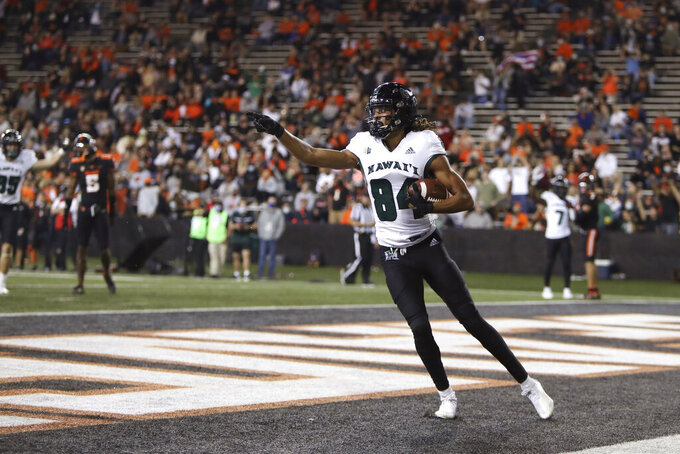 Hawaii wide receiver Nick Mardner (84) scores a touchdown during the second half of an NCAA college football game against Oregon State Saturday, Sept. 11, 2021, in Corvallis, Ore. Oregon State won 45-27. (AP Photo/Amanda Loman)