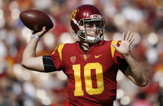 FILE - In this Oct. 27, 2018, file photo, Southern California quarterback Jack Sears throws against Arizona State during the first half of an NCAA college football game in Los Angeles. Sears has entered the transfer portal after failing to win the starting job in a four-man competition. Sears, a redshirt sophomore, announced his plans in a statement he posted to Twitter on Tuesday, Aug. 27. Sears' decision came less than one week after coach Clay Helton announced sophomore J.T. Daniels would start for the second straight season. (AP Photo/Marcio Jose Sanchez, File)