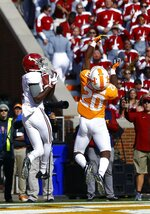 Alabama wide receiver Jerry Jeudy (4) catches a pass for a touchdown over Tennessee defensive back Bryce Thompson (20) in the first half of an NCAA college football game Saturday, Oct. 20, 2018, in Knoxville, Tenn. (AP Photo/Wade Payne)