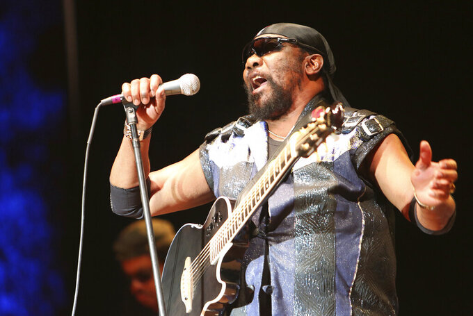 REMOVES REFERENCE TO COVID-19 - In this July 13, 2019 file photo, Toots Hibbert performs with the Maytals in Grass Valley, Calif.  In a statement from a family member Hibbert died on Friday, Sept. 11, 2020. (Elias Funez/The Union via AP)