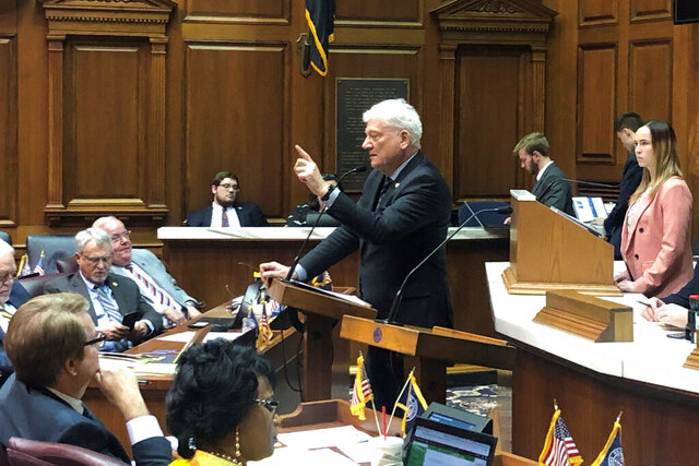 State Rep. Ed Soliday, R-Valparaiso, speaks about a bill aimed at making it more difficult for Indiana electric companies to close more coal-fired power plants during Indiana House debate on Monday, Feb. 3, 2020, at the Statehouse in Indianapolis. House members voted 52-41 in favor of the bill, which faces objections from consumer and environmental groups who argue it could stifle growth in renewable energy such as wind and solar power. (AP Photo/Tom Davies)