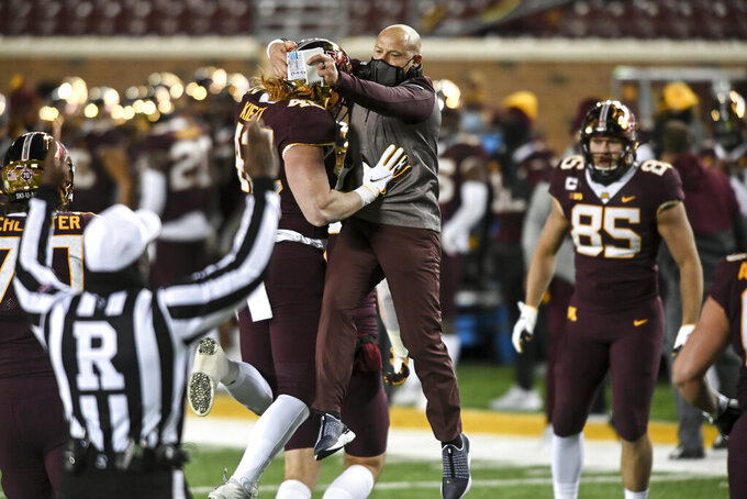 FILE - In this Saturday, Oct. 24, 2020, file photo, Minnesota head coach P.J. Fleck celebrates a touchdown by tight end Ko Kieft (42) in the first half of an NCAA college football game against Michigan, in Minneapolis. Fleck has never lacked for clever ways to connect and motivate his players. (Aaron Lavinsky/Star Tribune via AP, File)