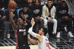 Miami Heat forward Bam Adebayo, left, shoots as Los Angeles Clippers center Ivica Zubac defends during the first half of an NBA basketball game Wednesday, Feb. 5, 2020, in Los Angeles. (AP Photo/Mark J. Terrill)
