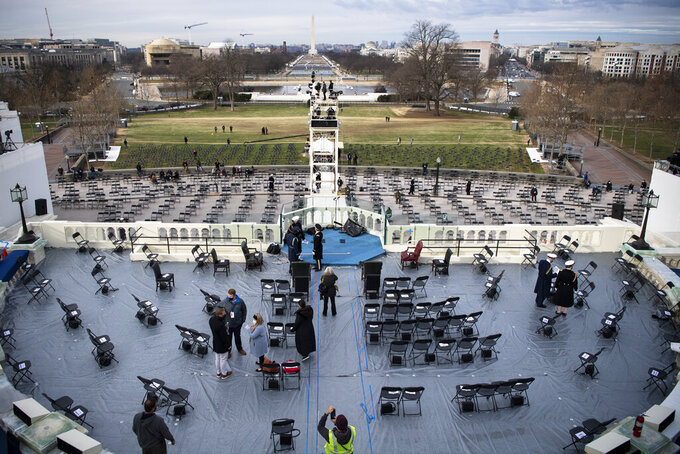 Preparations are made prior to a dress rehearsal for the 59th inaugural ceremony for President-elect Joe Biden and Vice President-elect Kamala Harris on Monday, January 18, 2021 at the U.S. Capitol in Washington. (Caroline Brehman/Pool via AP)