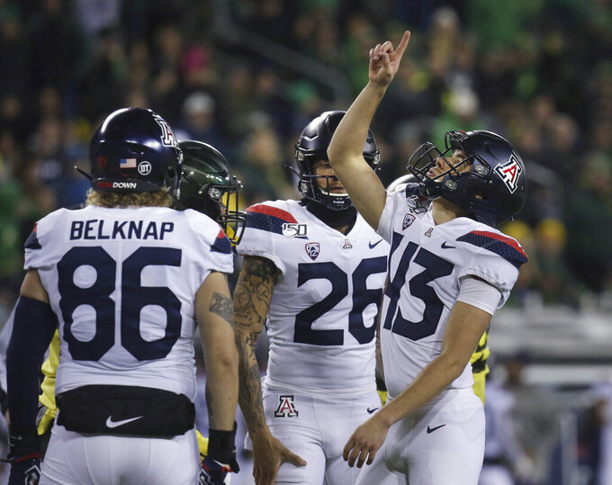 Arizona kicker Lucas Havrisik, right, points to the sky after a second-quarter field goal against Oregon in an NCAA college football game Saturday, Nov. 16, 2019, in Eugene, Ore. (AP Photo/Chris Pietsch)