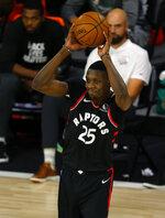 Toronto Raptors' Chris Boucher looks to pass against the Milwaukee Bucks during the second quarter of an NBA basketball game Monday, Aug. 10, 2020, in Lake Buena Vista, Fla. (Mike Ehrmann/Pool Photo via AP)