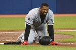 Chicago White Sox's Eloy Jimenez grimaces after being hit on the foot by a pitch from Toronto Blue Jays' Robbie Ray during the sixth inning of a baseball game Wednesday, Aug. 25, 2021, in Toronto. (Jon Blacker/The Canadian Press via AP)