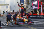 Red Bull Racing driver Max Verstappen waves to fans after doing doughnuts along Hollywood Boulevard in the Hollywood section of Los Angeles on Wednesday, Oct. 30, 2019. The street was thronged with thousands of fans craning for a glimpse of the drivers whose sport has worldwide popularity, but makes a relatively small imprint on the lucrative U.S. market. With the United States Grand Prix in Texas this weekend, the drivers were eager to raise F1's profile on the West Coast. (AP Photo/Richard Vogel)