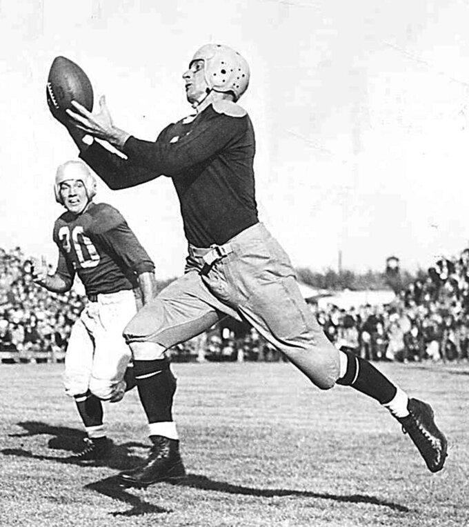 "FILE - In this 1946 file photo, Green Bay Packers' Don Hutson makes a catch. When he retired after the 1945 season, Green Bay receiver Don Hutson had a record 488 catches. The next most at that time was 190. The ""Alabama Antelope"" had 99 career touchdown grabs, a record that stood for more than four decades. (Milwaukee Journal-Sentinel via AP)"