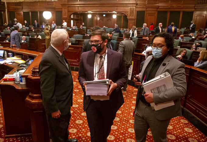 Staff leave floor of the Illinois House of Representatives after the budget is passed around midnight on the last day of session at the Illinois State Capitol in Springfield, Ill., Tuesday, June 1, 2021. (Justin L. Fowler/The State Journal-Register via AP)/The State Journal-Register via AP)