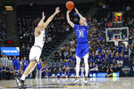 BYU guard TJ Haws (30) shoots as Utah State guard Abel Porter (15) defends in the first half during an NCAA college basketball game Saturday, Dec. 14, 2019, in Salt Lake City. (AP Photo/Rick Bowmer)