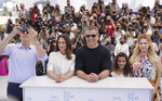 Director Tom McCarthy, from left, Camille Cottin, Matt Damon, Lilou Siauvaud, and Abigail Breslin pose for photographers at the photo call for the film 'Stillwater' at the 74th international film festival, Cannes, southern France, Friday, July 9, 2021. (AP Photo/Brynn Anderson)