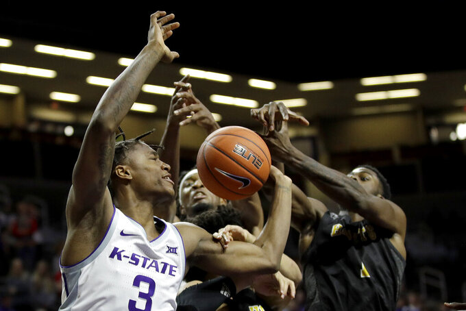 Kansas State's DaJuan Gordon (3) battles for a rebound during the second half of an NCAA college basketball game against Alabama State Wednesday, Dec. 11, 2019, in Manhattan, Kan. (AP Photo/Charlie Riedel)