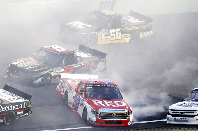 Brennan Poole (30) spins out during a NASCAR Truck Series auto race Saturday, June 13, 2020, in Homestead, Fla. (AP Photo/Wilfredo Lee)
