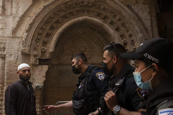 Israeli police checks on a worshipper as he arrives for the first Friday prayers during the Muslim holy month of Ramadan at the Dome of the Rock Mosque in Jerusalem's Old City , Friday, April 16, 2021. (AP Photo/Maya Alleruzzo)