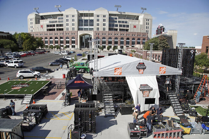 "Workers set up the ESPN College GameDay stage in front of Memorial Stadium in Lincoln, Neb., Thursday, Sept. 26, 2019. Nebraska's NCAA college football game against No. 5 Ohio State on Saturday night was always going to be a big one. Add a visit from ESPN's ""College GameDay"" show in the morning, and it becomes huge. (AP Photo/Nati Harnik)"