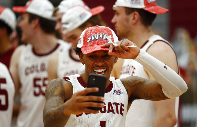 Colgate's Jordan Burns (1) celebrates after Colgate beat Loyola (Md.), in an NCAA college basketball game in the finals of the Patriot League tournament, Sunday, March 14, 2021, in Hamilton, N.Y. (AP Photo/John Munson)