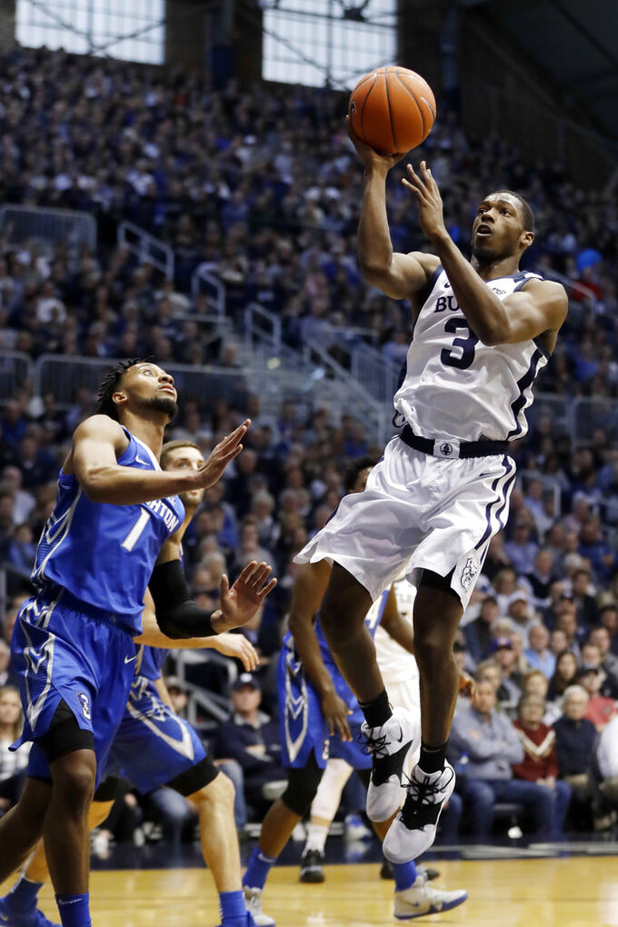 Butler's Kamar Baldwin (3) puts up a shot against Creighton's Davion Mintz (1) during the first half of an NCAA college basketball game, Saturday, Jan. 5, 2019, in Indianapolis. (AP Photo/Darron Cummings)