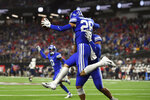 BYU defensive back Hayden Livingston (28) celebrates with a teammate after intercepting the ball against Arizona during the second half of an NCAA college football game Saturday, Sept. 4, 2021, in Las Vegas. (AP Photo/David Becker)