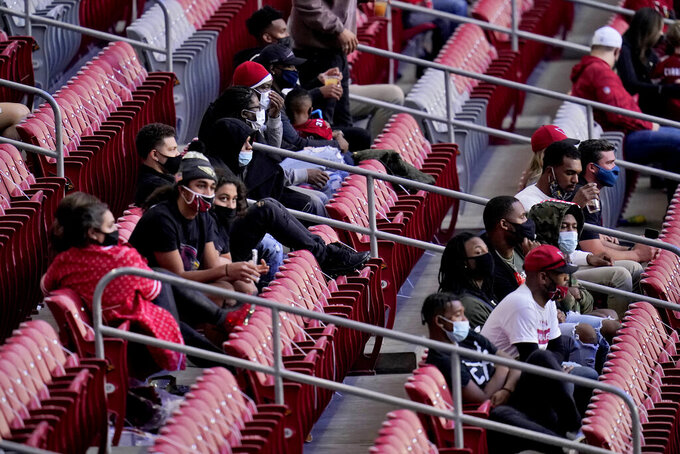 Fans watch during the second half of an NFL football game between the Los Angeles Rams and the Arizona Cardinals, Sunday, Dec. 6, 2020, in Glendale, Ariz. (AP Photo/Ross D. Franklin)