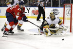 Vegas Golden Knights goaltender Marc-Andre Fleury, right, defends the goal as Florida Panthers center Vincent Trocheck (21) watches the puck during the second period of an NHL hockey game, Thursday, Feb. 6, 2020, in Sunrise, Fla. (AP Photo/Lynne Sladky)