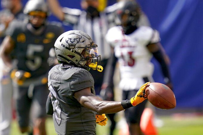 Pittsburgh wide receiver Jordan Addison (3) tosses the ball after making a touchdown catch against Louisville during the first half of an NCAA college football game, Saturday, Sept. 26, 2020, in Pittsburgh. (AP Photo/Keith Srakocic)