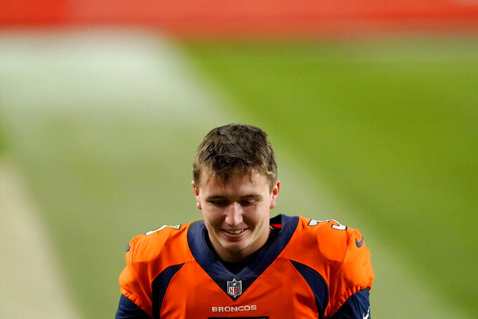 Denver Broncos quarterback Drew Lock (3) smiles as he leaves the field after an NFL football game against the Miami Dolphins, Sunday, Nov. 22, 2020, in Denver. The Broncos won 20-13. (AP Photo/Jack Dempsey)