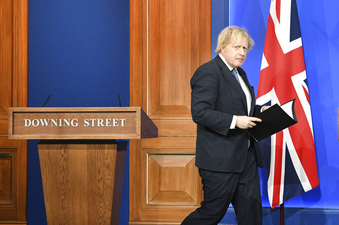Britain's Prime Minister Boris Johnson arrives for a coronavirus briefing in Downing Street, London, Monday April 5, 2021. (Stefan Rousseau/Pool via AP)
