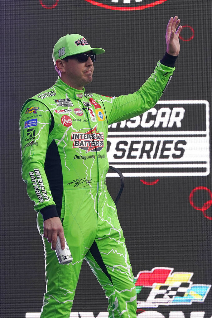 Kyle Busch waves to fans during driver introductions before the NASCAR Cup Series auto race at Daytona International Speedway, Saturday, Aug. 28, 2021, in Daytona Beach, Fla. (AP Photo/John Raoux)
