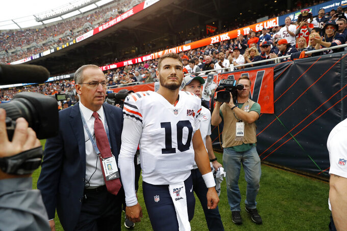 FILE - In this Sunday, Sept. 29, 2019, file photo, Chicago Bears quarterback Mitchell Trubisky walks to the locker room after being injured during the half of an NFL football game against the Minnesota Vikings, in Chicago. The Bears envisioned Trubisky showing why he was drafted with the No. 2 overall pick in 2017 and a more dynamic offense helping take the load off one of the NFL's best defenses in coach Matt Nagy's second season. So far, it's not happening. (AP Photo/Charles Rex Arbogast, File)