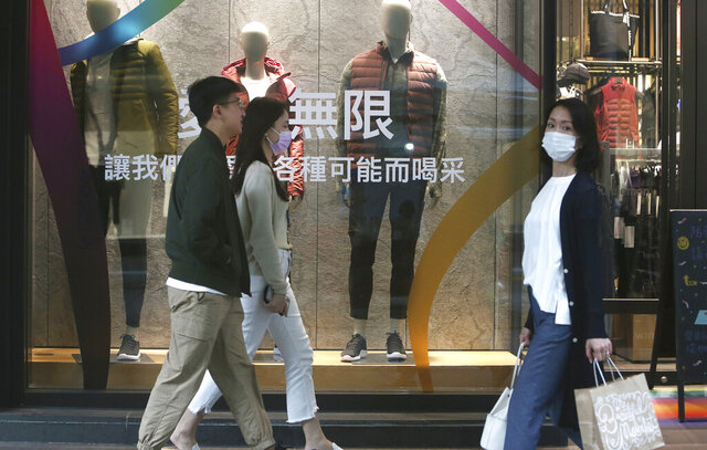 People wear face masks to protect against the spread of the coronavirus as they walk through a shopping district in Taipei, Taiwan, Thursday, Oct. 29, 2020. (AP Photo/Chiang Ying-ying)