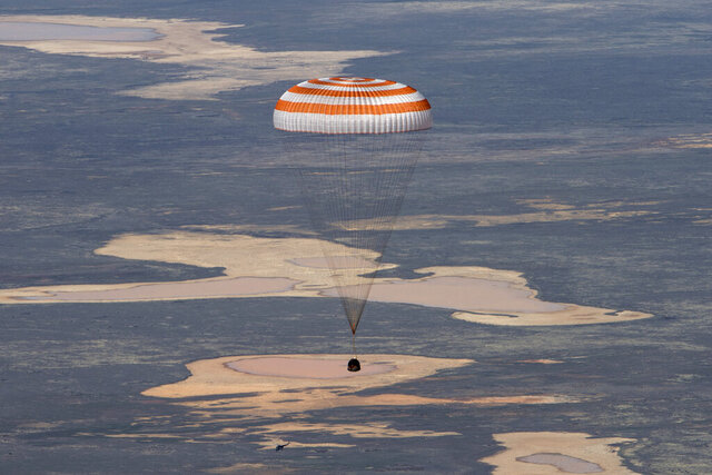 In this handout photo released by Gagarin Cosmonaut Training Centre (GCTC), Roscosmos space agency, the Soyuz MS-15 space capsule carrying International Space Station (ISS) crew members descends beneath a parachute just before landing in a remote area near Kazakh town of Dzhezkazgan, Kazakhstan, Friday, April 17, 2020. An International Space Station crew has landed safely after more than 200 days in space. The Soyuz capsule carrying NASA astronauts Andrew Morgan, Jessica Meir and Russian space agency Roscosmos' Oleg Skripochka touched down on Friday on the steppes of Kazakhstan. (Andrey Shelepin, Gagarin Cosmonaut Training Centre (GCTC), Roscosmos space agency, via AP)