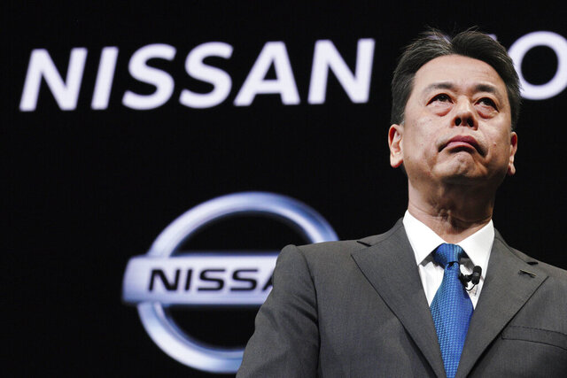 FILE - In this Dec. 2, 2019, file photo, Nissan Chief Executive Makoto Uchida speaks during a press conference at the automaker's headquarters in Yokohama, near Tokyo. Japanese securities regulators are recommending that automaker Nissan be fined 2.4 billion yen ($22 million) for the under-reporting of compensation of its former chairman, Carlos Ghosn. The Securities and Exchange Surveillance Commission said Tuesday, Dec. 10, 2019, it made the recommendation to the government's Financial Services Agency. (AP Photo/Eugene Hoshiko, File)
