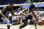 Arizona forward Zeke Nnaji, right, reaches for a loose ball against Penn guard Eddie Scott, left, in the second half of an NCAA college basketball game at the Wooden Legacy tournament in Anaheim, Calif., Friday, Nov. 29, 2019. (AP Photo/Alex Gallardo)