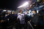 Seattle Seahawks' Russell Wilson greets fans after an NFL wild-card playoff football game against the Philadelphia Eagles, Sunday, Jan. 5, 2020, in Philadelphia. Seattle won 17-9. (AP Photo/Matt Rourke)